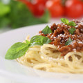 Spaghetti bolognese noodles pasta meal with ground meat tomatoes and on a plate Stock Photos