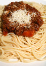 Spaghetti bolognese with parmesan vertical Royalty Free Stock Photos