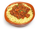 Spaghetti bolognese served in a terracotta dish Royalty Free Stock Images