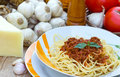 Spaghetti bolognese topped with sauce Royalty Free Stock Image
