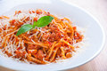 Spaghetti bolognese on white plate with tomato sauce and basi Royalty Free Stock Photo