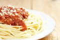 Spaghetti bolognese on white plate wooden table Royalty Free Stock Image