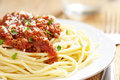Spaghetti bolognese on white plate wooden table Stock Photos