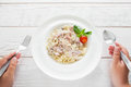 Spaghetti carbonara eating, eater pov, flat lay Royalty Free Stock Photo
