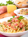 Spaghetti carbonara with ingredients Royalty Free Stock Photography