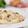 Spaghetti carbonara noodles pasta meal with ham on a plate Royalty Free Stock Photography
