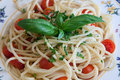Spaghetti cherry tomatoes and basil dish with Stock Images