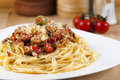 Spaghetti with cherry tomatoes sauce on white plate Stock Image