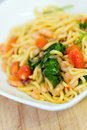 Spaghetti close up of with prawns spinach and tomatoes Royalty Free Stock Photos