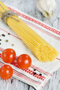 Spaghetti, dry pepper, tomatoes and garlic Stock Photography
