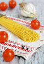 Spaghetti dry pepper tomatoes garlic towel Stock Photo