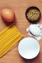Spaghetti, egg, flour, oregano species Stock Photos