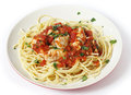 Spaghetti with fish in arrabbiata sauce all garnished parsley the is made from tomato garlic olive oil and flaked chillis Stock Images