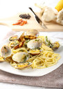 Spaghetti with fresh clams, garlic and parsley Stock Images