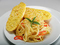 Spaghetti and garlic bread Royalty Free Stock Photo