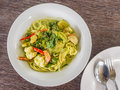 Spaghetti and green curry sauce cuisine thai Stock Photo