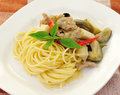 Spaghetti with green pork curry Stock Photo
