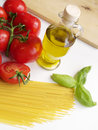Spaghetti ingredients image of fresh and genuine italian tomatoes olive oil and basil for mediterranean diet Royalty Free Stock Photos