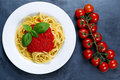Spaghetti with marinara sauce and basil leaves on top Royalty Free Stock Photo