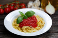 Spaghetti with marinara sauce and basil leaves on top, decorated Royalty Free Stock Photo