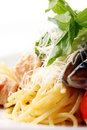 Spaghetti and meat with cheese basil and mussels Stock Images