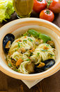 Spaghetti with mussels and capers dish of italian pasta stuffed mediterranean cuisine Royalty Free Stock Image