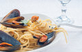 Spaghetti with mussels tomato and parsley Royalty Free Stock Photos
