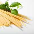 Spaghetti pasta with basil leaf on white background Royalty Free Stock Images
