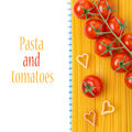 Spaghetti pasta in the form of heart cherry tomatoes isolated hearts and on white Stock Photos