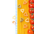 Spaghetti pasta in the form of hearts and cherry tomatoes concept isolated on white Royalty Free Stock Images