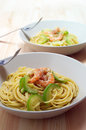 Spaghetti pasta with fresh shrimps and zucchini Royalty Free Stock Photos