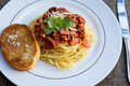 Spaghetti pasta with garlic bread. Royalty Free Stock Photo