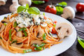Spaghetti pasta salad with tomato sauce, mushrooms, blue cheese and basil Royalty Free Stock Photo