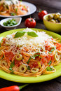 Spaghetti pasta salad with tomato sauce, olives, Gouda cheese and basil Royalty Free Stock Photo