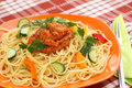 Spaghetti pasta with sauce and vegetables on table Stock Photography