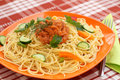 Spaghetti pasta with sauce and vegetables on table Royalty Free Stock Photos