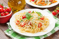 Spaghetti and penne pasta with tomatoes and basil on wooden table Royalty Free Stock Photo