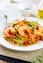 Spaghetti with prawn and tomato cherry rocket con gamberetti e rucola Royalty Free Stock Photos