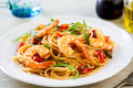Spaghetti with prawn and tomato cherry rocket con gamberetti e rucola Stock Image