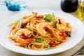 Spaghetti with prawn and tomato cherry rocket con gamberetti e rucola Stock Image