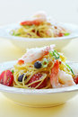 Spaghetti with prawns and asiago cheese and cherry tomatoes Stock Photo