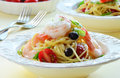 Spaghetti with prawns and asiago cheese and cherry tomatoes Stock Image