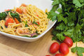 Spaghetti with prawns spinach and tomatoes Stock Image