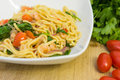 Spaghetti with prawns spinach and tomatoes Stock Images