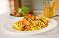Spaghetti with pumpkin and pea rocker salad and tomato glass with drink sprinkled cheese spilled oil rocket cherry on Stock Images