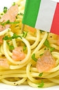 Spaghetti with salmon and the flag of italy Royalty Free Stock Photo