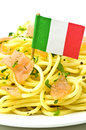 Spaghetti with salmon and the flag of italy Royalty Free Stock Photography