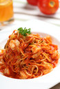 Spaghetti with seafood and water on the table Stock Photography