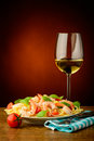 Spaghetti with shrimps and wihte wine Royalty Free Stock Photo