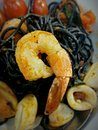 Spaghetti strands black ink and shrimp Royalty Free Stock Photography